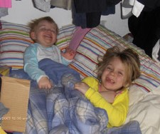 Hannah and Summer enjoy a fort in the closet